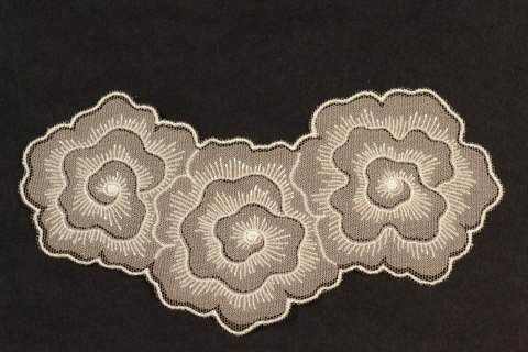 Embroidered appliques in light beige colour