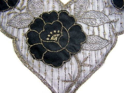 Black and gold appliques on tulle