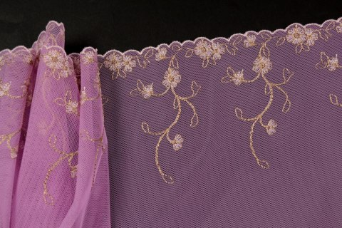 Embroidered lace in lila color
